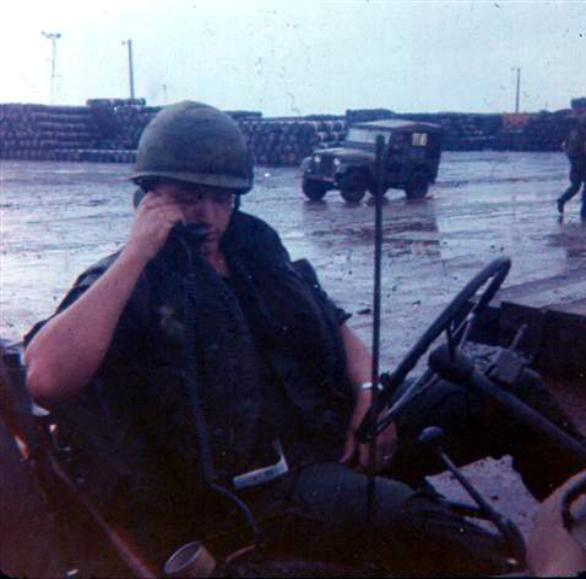 Sgt. Krabbenhoeft - Note All The Barrels Stacked In The Background - Lots Of Agent Orange