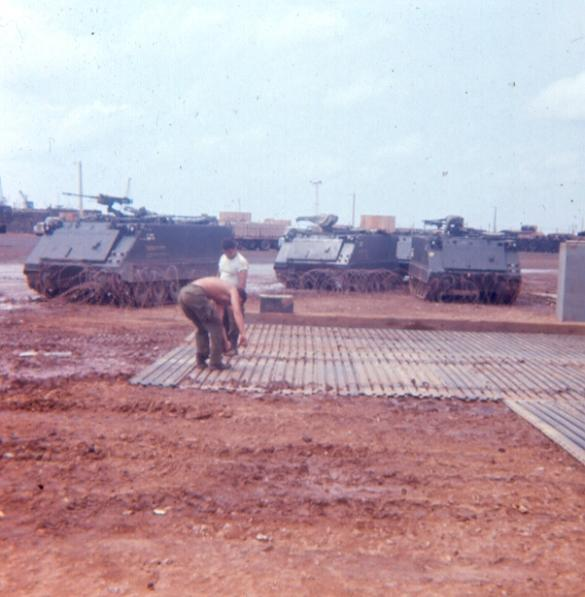 Left Photo - Laying Sections Of Portable Landing Strip For APC Parking Outside Guard Quarters - Robert Banbury is the GI With His Shirt Off -  Right Photo - Guards  Schaub, Burton and Tipton Washing APC On The Docks