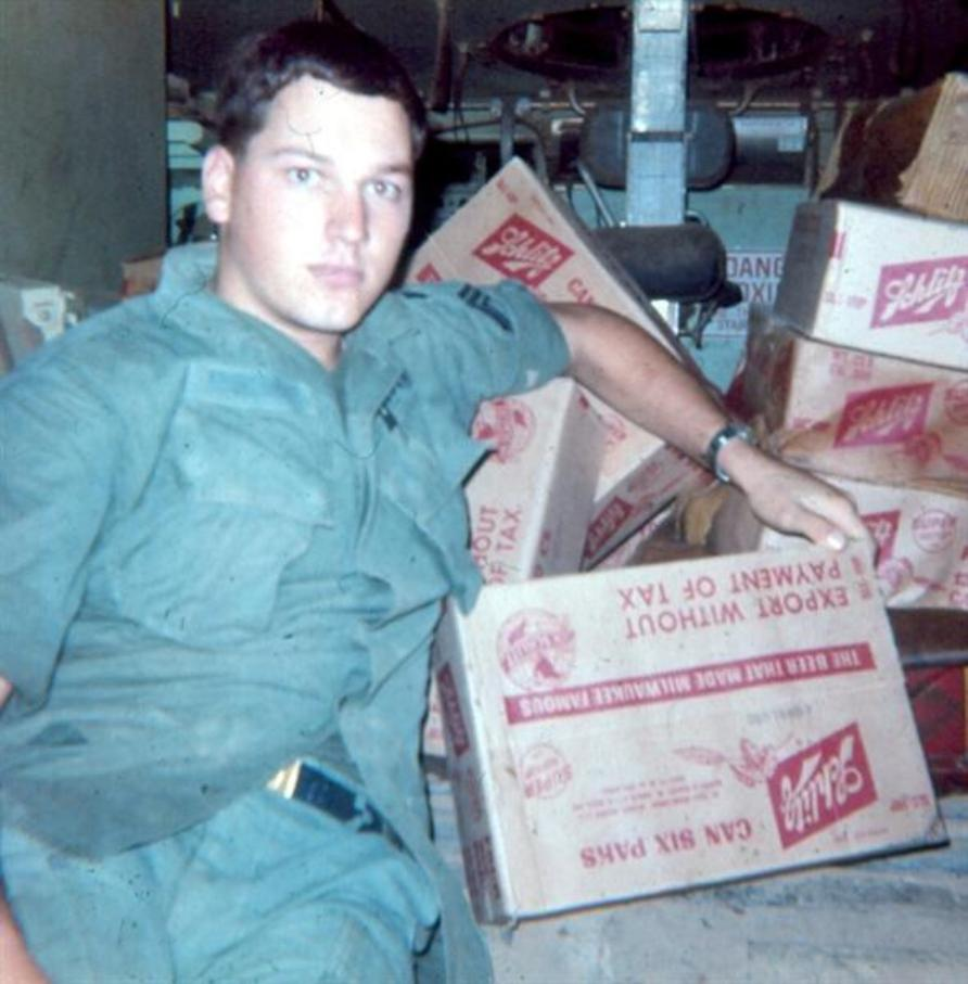 Sgt. Al Krabbenhoeft With The Rewards Of A Night Raid On A Pallet Of Beer