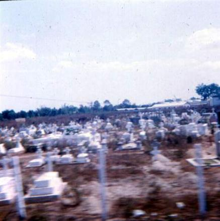 February 2, 1968 - Photo Taken From APC Position West Of Maintenance Building - The Discoloration On Right Side Of Concrete  Railing Wall Of Bridge Is From Newport Personnel Firing At The VC - This View Gives You A Good Idea Where The VC Were When The  Exchange Of Fire Began. Tu Duc Cemetery Off Highway #1 - This Is Where The VC Stockpiled Weapons In Graves In Preparation For TET