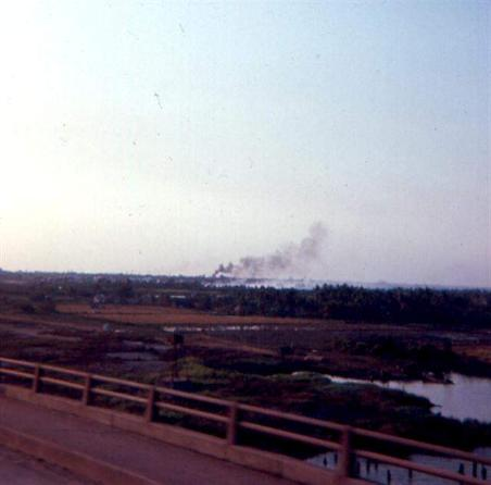 Left -  Morning Of February 2, 1968 Most Of The Smoke In Background Is Ton Son Nhut Air Base Burning - Right  - Photo Taken From Newport Bridge Also Looking  Toward Ton Son Nhut Area