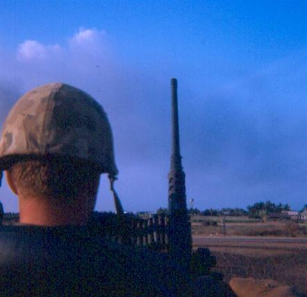 Left  -  Newport  Guards At  Front Gate - Right  -  SP/4  Warren Schaub  Looking  Out  Main  Gate  Of  Newport -  Small Building To The Right Is Where The Majority Of Enemy Fire Was Generated The Late Hours Of February 1, 1968