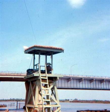 Left - February 2, 1968 -  The Remains Of  One Of  The Guard  Towers  Located At  The Old Mess  Hall Near The Bridge - Note Almost  All  The Sandbags  On The  Tower Were  Shot To  Pieces -  Right - Photo  Taken  From  Back  Perimeter Of Newport - More Fires In The Saigon Area