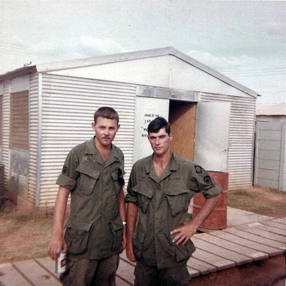 Buddy Hall with his high school friend, James Holland.  James was with another unit and came to see Buddy at Camp Camelot.