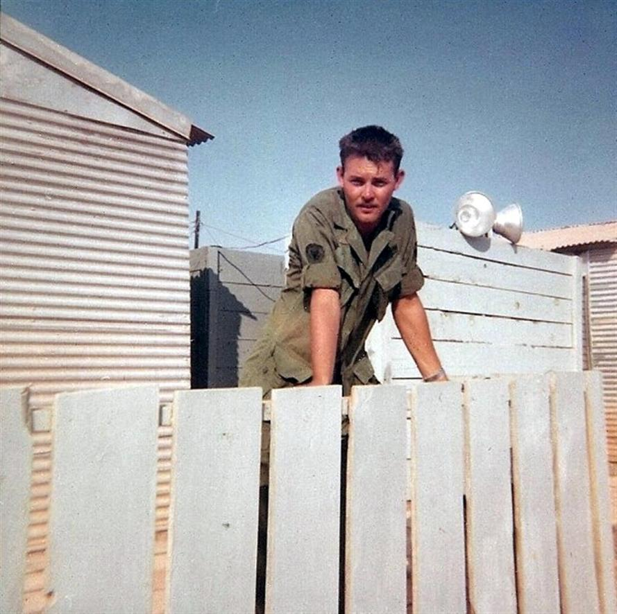 Buddy Hall Looking Over The Fence Next To His Hootch At Camp Camelot