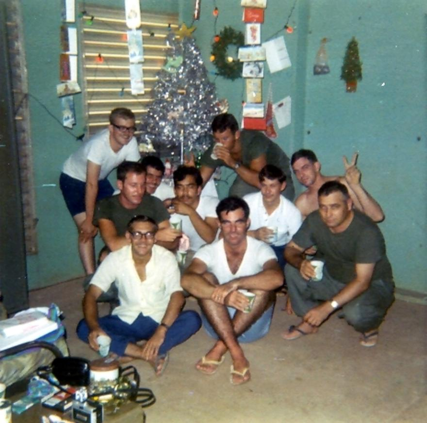 Christmas Morning 1969. Sitting from left to right, Glenn Davis, John Fay, SFC Turner, with Lightning Theriac in white shirt at Turner's elbow.