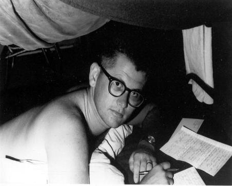 In my bunk writing home.  I still have all my letters I sent home to my ex-wife.  Note my Wally haircut and glasses.