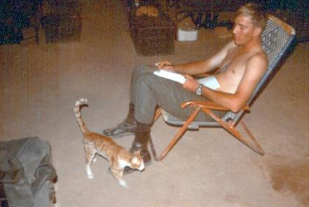 Left Photo - SP4 Ouellette (Our Barber) Getting Ready To Cut Another GI's Hair - Right Photo - Cats had a short life in Vietnam.