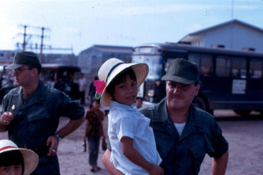 Left - Lt Vukovocan With One Of The Two Orphan Girls - Don't Remember The Name Of The GI Holding The Girl