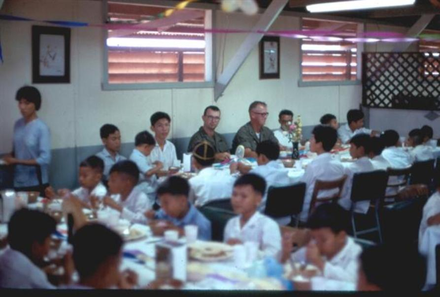 Meal At Our Mess Hall - Officers At The Table Are - Left - Lt Rich Vukovocan - Right - Bn. Co. Ltc John P. Santry