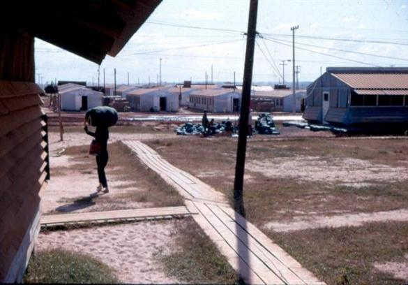 Far Left Photo - Chaplain Bob Wills -Left Photo - From Message Center Toward Rear Of Chapel Where The Sandbag Detail Was Located - I spent a lot of evenings after regular hours filling sandbags.  Right Photo - SP4 Peacock And SP4 Rex Dietz - Note start of new hootch on left. - Battalion Headquarters In Background