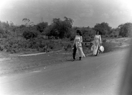 Two Young Girls Walking Down Charley Road