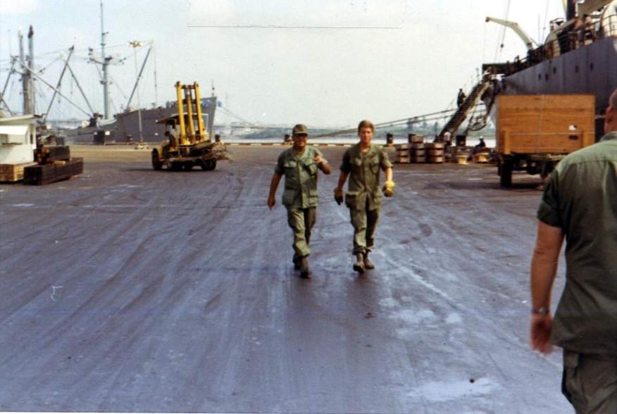 Two of our men that supervised cargo at the ship, barge and LST sites.