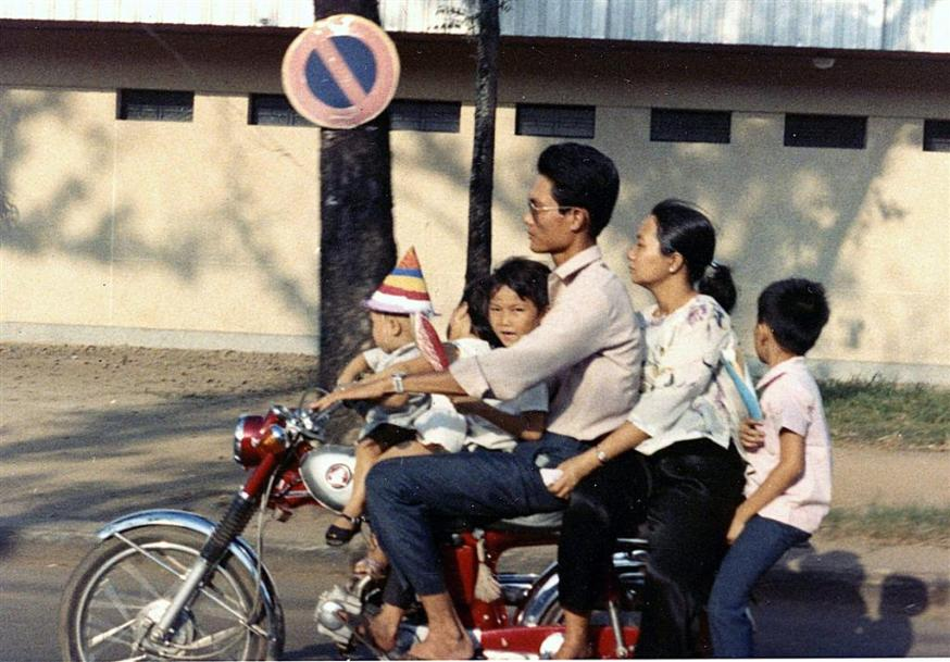Family Transportation - Six On A Motor Bike
