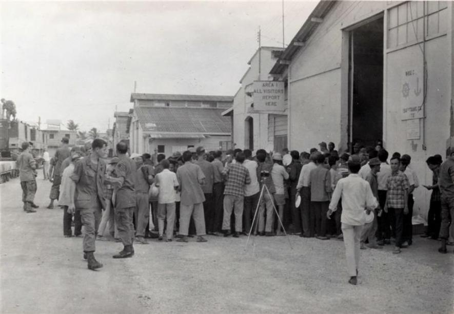 Saigon Port Party 1969 - The sign on the building next to the open door reads