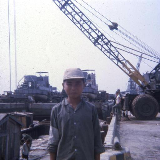 Vietnamese Boy At Barge Site