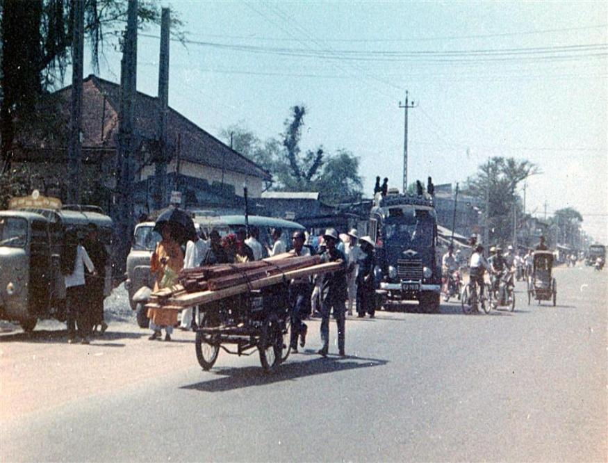 Hauling Lumber And Funeral Procession In Gia Dinh