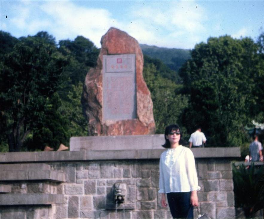 Don't know who the young lady is.  Probably a friend of Jims.  She is standing in front of some memorials.  This is where the Japanese had their last stand against the U.S. forces during WWII.  There is a steep cliff there and many Japanese soldiers jumped off that cliff instead of being taken prisoner.
