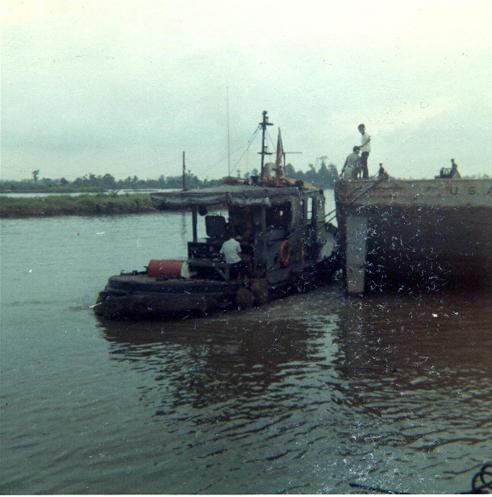 The Tugboat That Brings The Barges To The Piers
