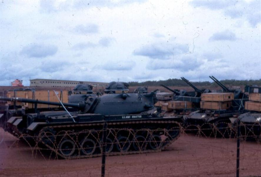 Brand New Tanks And Other Track Vehicles On Long Bien Post Waiting To Go To Their Final Destination - Our men unloaded these from ships at Newport and drove them here.   One of the USARV Headquarters Buildings is visible in the background