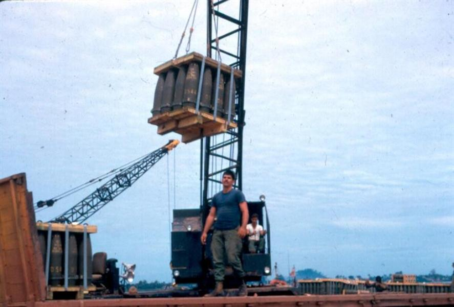 Right - Crane Unloading 155mm Shells From River Barge To Trucks At The Cogido Barge Site - This was the nearest site our men worked at, about a mile or so from Camelot. - Left - Picking Up The Guys For A Barge Site Service At The Bien Hoa Site