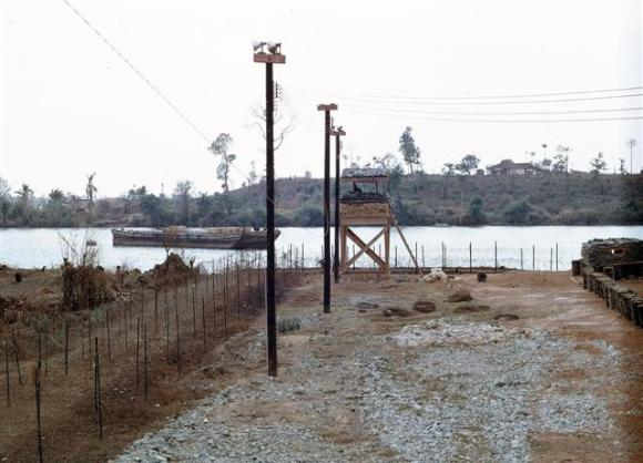 Guard Tower At Binh Hoa Site With Ammo Barge Moored