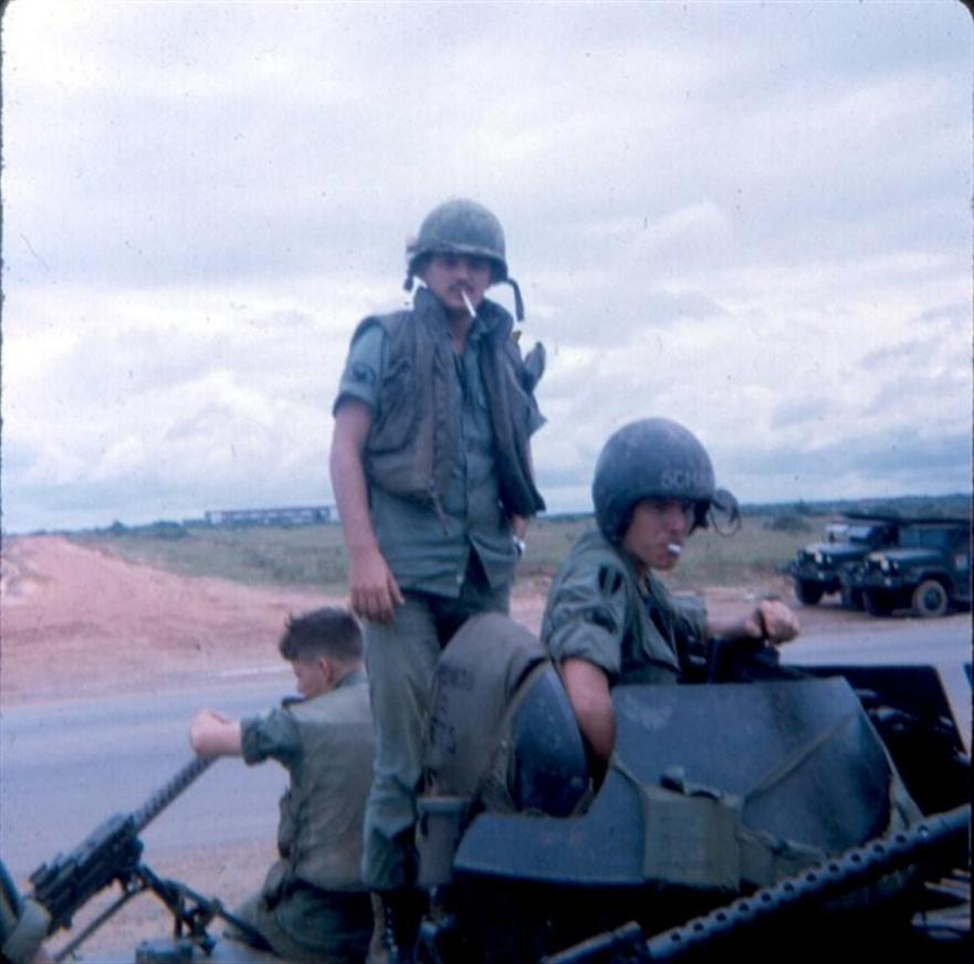 Left Photo - Me And Warren Schaub - Saigon University In Background  - Anyone got a light? - Right Photo -  August 1968 - Bear Cat Road AKA Charlie Road - Heading Towards Camp Camelot And Bearcat - The road is now paved. It wasn't like that when we got here in 67.