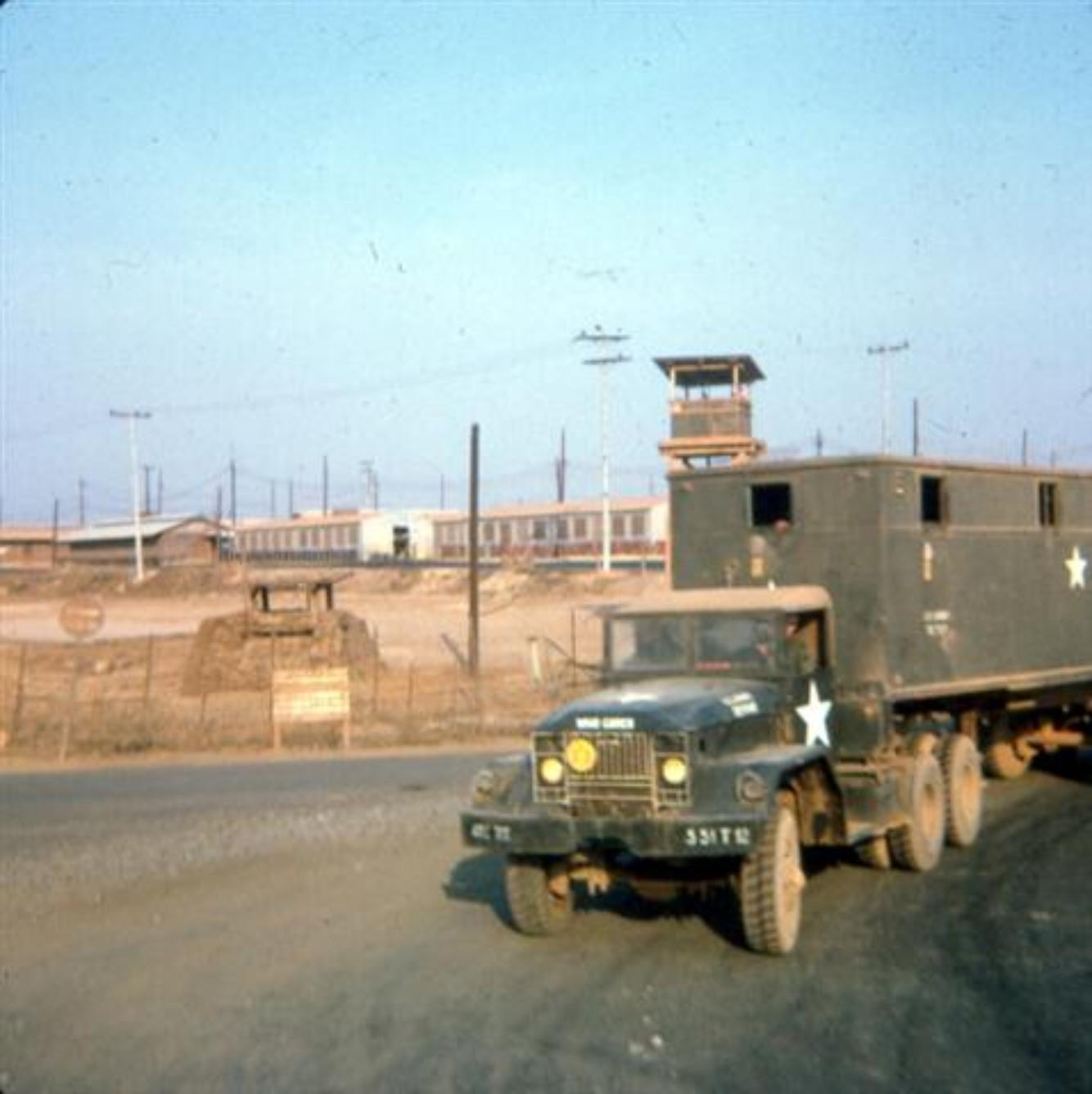 Making The Run To Newport-Photo Taken At The Corner Of 1A And Bear Cat Road, Also Called Charlie Road The buildings in the background are transportation units, located in the area they called TC Hill,on Long Binh Post.