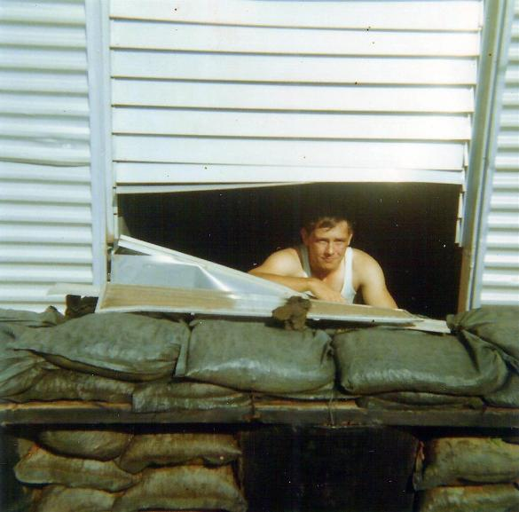 Randy Richmond Looking Through A Hole In His Hootch Where A Piece Of The Roof Went Through