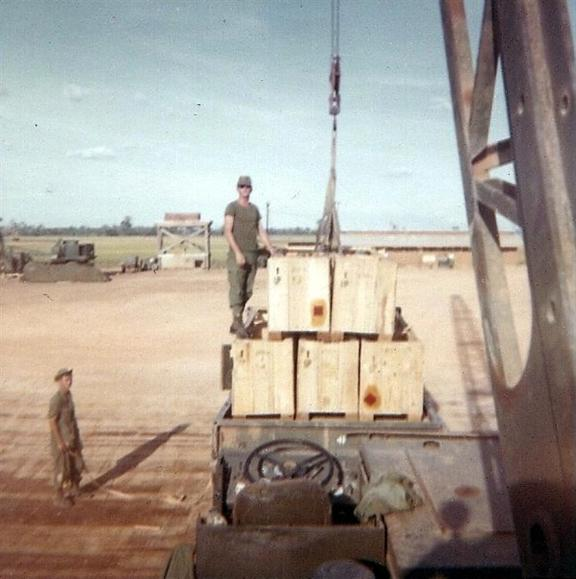 Wiley Standing On Some Cargo And Then Operating The Crane