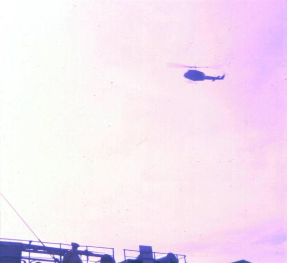 Another Huey Flying Over The Port